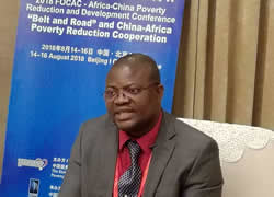 Deputy Minister for Economic Management Hon Augustine Flomo speaking at Africa China Poverty Reduction and Development Conference in Beijing China