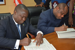 Finance Minister Hon Samuel D Tweah Jr and Mr Orison M Amu Country Manager of the Country Office of the African Development signs 10M as Budget S