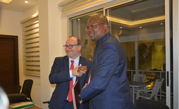 Hon. A. J.Flomo Deputy Minister for Economic Management in a handshake with Director General of the AFD Mr. Remy Rioux